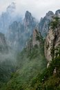 Grotesque rocks on foggy mt huangshan anhui province Stock Photo