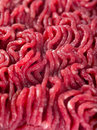 Ground beef background macro photo of fresh focus through the middle of image Stock Photos