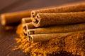 Ground cinnamon and cinnamon sticks Royalty Free Stock Photo