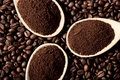 Ground coffee on coffee beans Stock Photo