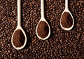 Ground coffee on coffee beans Royalty Free Stock Photo
