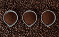 Ground coffee on coffee beans Stock Photos