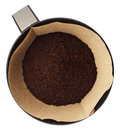 Ground coffee in filter holder isolated on white background over Royalty Free Stock Image