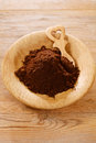 Ground coffee powder in wooden plate Royalty Free Stock Images