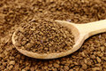 Ground coffee with wooden spoon Royalty Free Stock Photography