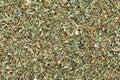 Ground dried Basil (Sweet Basil) background. Royalty Free Stock Photo