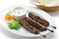 Ground lamb kebab with flat bread Stock Images