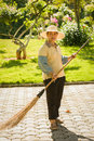 Grounds maintenance more part of waitstaff in xishuangbanna tropical flowers plants garden are womans Stock Image