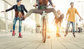 Group of active teenagers in town. four teens making recreational activity in an urban area Royalty Free Stock Photo