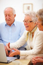 Group of aged people using a laptop Royalty Free Stock Photo