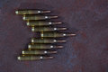 Group of ammunition on a metal background