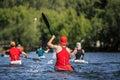 Group of athletes canoeists boating on  lake Royalty Free Stock Photo