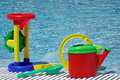 Group Of Beach Plastic Colorful Child Toys At The Poolside Royalty Free Stock Photo