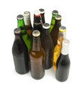 Group of beer bottles isolated studio shot green and brown Royalty Free Stock Photo