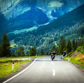 Group of bikers in mountains riding beautiful mountainous landscape green forest leisure time holiday and vacation concept Royalty Free Stock Images