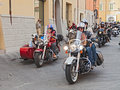 A group of bikers riding harley davidson american motorbikes and sidecar at motorcycle rally sangiovese tour by ravenna chapter on Royalty Free Stock Photo
