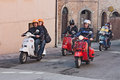 Group of bikers riding a vintage italian scooters vespa at motorcycle rally of vespa club santarcangelo di romagna on april in Royalty Free Stock Images