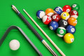 Group of billiard colored balls, cues and triangle