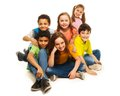 Group of black and caucasian kids sitting happy together smiling and laughing Stock Images