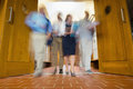 Group of blurred people walking through open doors low angle view a Royalty Free Stock Images