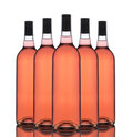 Group of Blush Wine Bottles Royalty Free Stock Photo