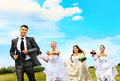 Group bride and groom summer outdoor wedding Stock Photo