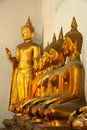 Group of Buddhas in the wall at church . Royalty Free Stock Photos