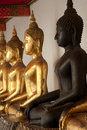 Group of Buddhas in the wall at church . Stock Photos