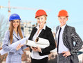Group of builders workers construction industry background Stock Image