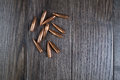 Group of bullets on wooden background