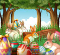 A group of bunnies and easter eggs illustration on white background Royalty Free Stock Image