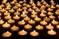 Group of burning candles at a black background Royalty Free Stock Photo
