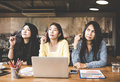 Group business asia woman looking and thinking something ideas in workspace, casual outfit Royalty Free Stock Photo