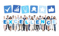 Group of business holding word excellence multi ethnic and casual people placards that form Royalty Free Stock Photography