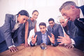 Group of business man predict the future men with a crystal ball Stock Photo