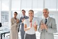 Group of business people applauding together during a meeting Royalty Free Stock Image