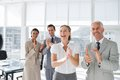 Group of business people applauding together in the meeting room Stock Image