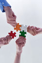 Group of business people assembling jigsaw puzzle and represent team support and help concept Stock Photo