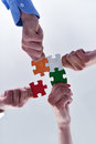 Group of business people assembling jigsaw puzzle and represent team support and help concept Stock Image