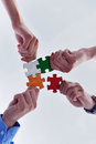 Group of business people assembling jigsaw puzzle and represent team support and help concept Royalty Free Stock Photo