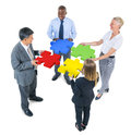 Group of business people building jigsaw Stock Image