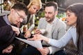 Group of business people in coffee shop partners talking and working bar Stock Images