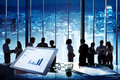 Group of business people in a conference room and tablet with statistics Stock Photography
