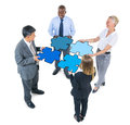 Group of Business People Connecting Jigsaw Puzzles Royalty Free Stock Photo