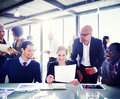 Group of business people expressing positivity around the conference table Royalty Free Stock Photos