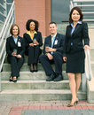 Group Of Business People In Front Of Building Stock Photo