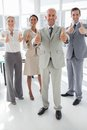 Group of business people giving thumbs up in the meeting room Stock Photography