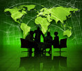 Group of business people on green world economic Stock Photography