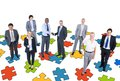 Group of Business People with Jigsaw Puzzle Royalty Free Stock Photo