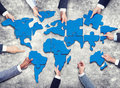 Group of Business People with Jigsaw Puzzle Forming in World Map Royalty Free Stock Photo